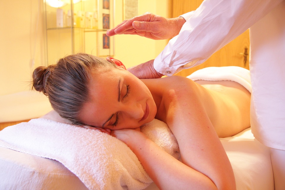 A woman gets a back massage at a spa