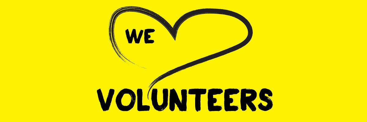 A yellow banner feat an illustration of a heart outlined in a black paintbrush style design. Text: We heart volunteers!