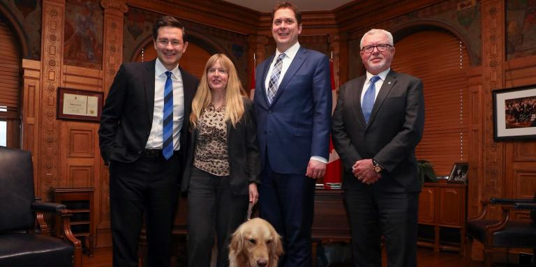 CNIB's Diane Bergeron, Vice President of Engagement and International Affairs, stands with Members of Parliament Pierre Poilievre and Andrew Scheer.