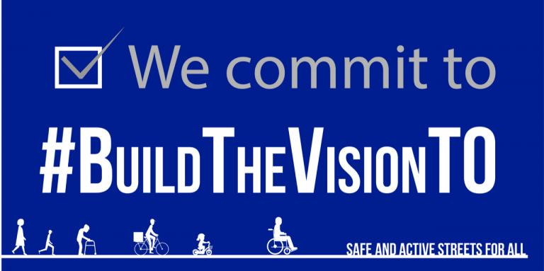"A blue banner with a check box and text ""We commit to #BuildTheVisionTO. A cartoon graphic of pedestrians frames the text."