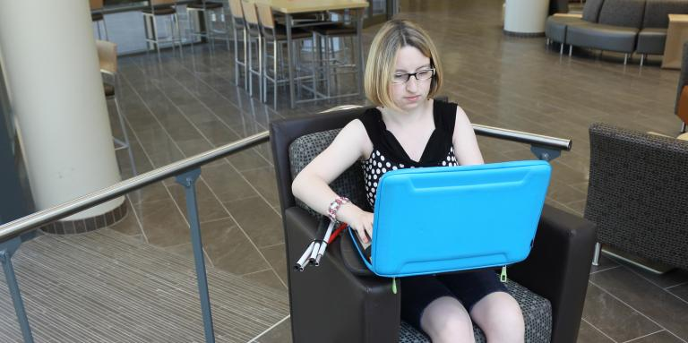 Young woman with sight loss uses a computer