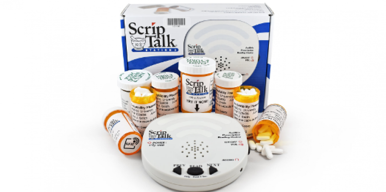 A ScripTalk Station Reader surrounded by pill bottles.
