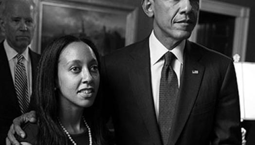 Haben Girma stands with Barrack Obama, while Joe Biden Stands in the background