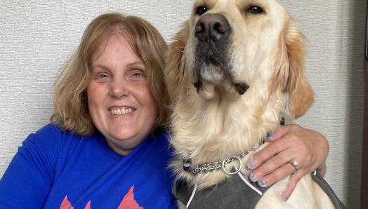 Chris Trudell-Conklin and her guide dog, Cody, a 2-year-old golden retriever.